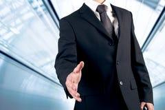 Mão da agitação do homem de negócio Fotos de Stock