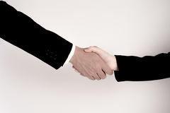 A mão da agitação do homem de negócios com a mulher de negócio no fundo branco Conceito da coordenação fotos de stock royalty free