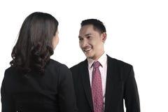 Mão da agitação do homem e da mulher de negócio Imagem de Stock