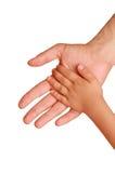 Mão da criança na mão de um homem Fotografia de Stock