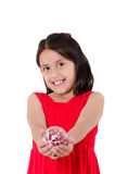 Mão da criança que guarda um ornamento dos christmass Imagem de Stock