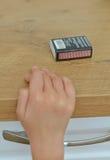 A mão da criança que toma fósforos Imagens de Stock Royalty Free