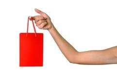 Mão da menina com um saco imagem de stock