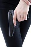 A mão da menina que guarda uma arma Imagem de Stock