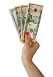 Mão da mulher com contas de dólar fotos de stock