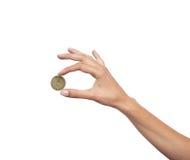 Mão da mulher com a moeda isolada Imagens de Stock