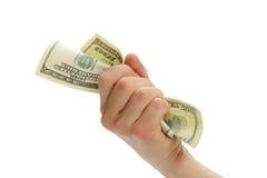 Mão da mulher com 100 notas de dólar Imagens de Stock