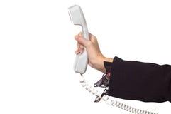 Mão da mulher com um receptor do telefone fotos de stock