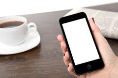 Mão da mulher de negócios que guarda um telefone na perspectiva do fotos de stock royalty free