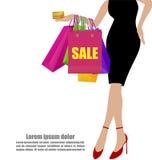 Mão da mulher em vestidos do preto com sacos de compras coloridos e Cred ilustração royalty free