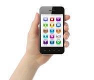 A mão da mulher guardara o telefone esperto com ícones Imagem de Stock
