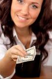 Mão da mulher nova que prende um dólar Fotografia de Stock Royalty Free