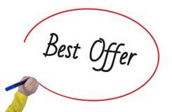 Mão da mulher que escreve a melhor oferta com marcador Imagens de Stock Royalty Free
