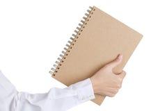 A mão da mulher que guarda um livro Foto de Stock