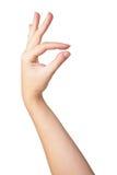 Mão da mulher que mede artigos pequenos invisíveis Foto de Stock Royalty Free