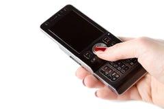 Mão da mulher que prende o telefone móvel fotos de stock
