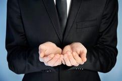 Mão da oferta do homem imagens de stock royalty free