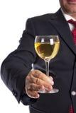 Mão da terra arrendada do vidro de vinho Fotos de Stock