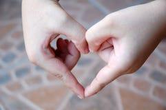 Mão das crianças Foto de Stock
