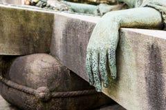 Mão de bronze de uma estátua Imagens de Stock