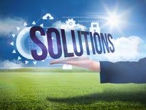 Mão de Businesswomans que apresenta as soluções da palavra Fotografia de Stock Royalty Free