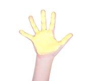 Mão de Childs com pintura amarela nela Fotografia de Stock Royalty Free