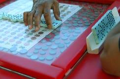 Mão de Dominoe Fotografia de Stock