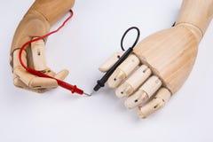Mão de madeira e multímetro bonde Fotografia de Stock Royalty Free