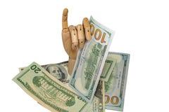 Mão de madeira que mantém o detalhe ascendente próximo dos dólares macro Fotografia de Stock Royalty Free