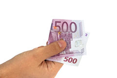 Mão de Man's que guarda cinco cem contas de dinheiro da cédula do Euro 500 mim Fotos de Stock Royalty Free