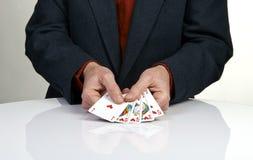 Mão de pôquer real dos cartões de jogo do resplendor reto nos corações Fotografia de Stock