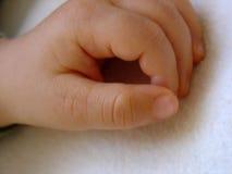 Mão de um bebê Foto de Stock
