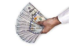 Mão de um homem que guarda notas de dólar Imagens de Stock