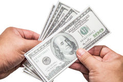 Mão de um homem que guarda um punhado ventilado de 100 dólares Fotos de Stock Royalty Free