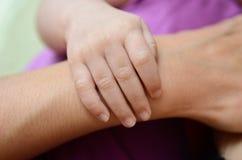 A mão do bebê Imagens de Stock