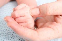 Mão do bebê Imagens de Stock
