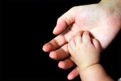Mão do bebê na palma da matriz Fotografia de Stock