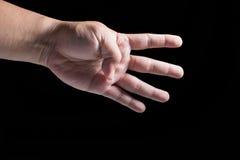 mão do ‰ do ¹ do à no fundo preto Fotografia de Stock Royalty Free