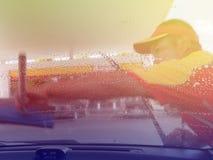 Mão do fundo de Blured com carro da limpeza Imagens de Stock Royalty Free