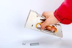 Mão do grampeador Fotos de Stock