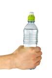 Mão do homem com frasco plástico fotografia de stock royalty free