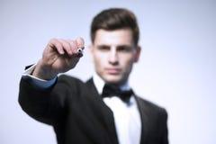 A mão do homem de negócio escreve Fotografia de Stock