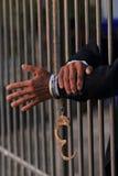 Mão do homem de negócio na cadeia fotos de stock