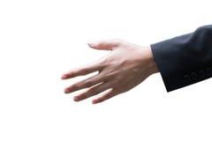 A mão do homem de negócios da foto do close up alcança para fora à verificação Foto de Stock Royalty Free