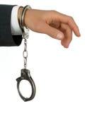 Mão do homem de negócios nas algemas fotografia de stock