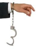 Mão do homem de negócios nas algemas fotografia de stock royalty free
