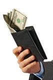 A mão do homem de negócios prende uma bolsa com dinheiro Foto de Stock