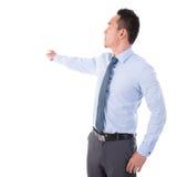 Mão do homem de negócios que aponta afastado Fotos de Stock