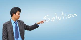 Mão do homem de negócios que empurra a solução Imagem de Stock Royalty Free