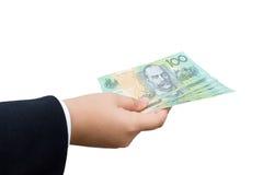 Mão do homem de negócios que guarda os dólares australianos (AUD) Imagem de Stock Royalty Free